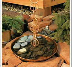 I am for sure going to be making a rain chain for myself and definitely want to put sime kind of pot or bowl to let the rain trickle down into. It will just add to the sound of rain..even a metal bucket upside down would be nice. Maybe sound like rain on a tin roof!