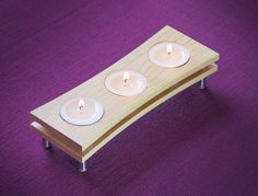 This simple candle holder is made from hardwood with metal legs. It comes with three tealights. _______________________________ MATERIALS Maple