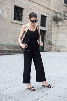 Stunning All Black Look Balenciaga Sunglasses Teamed With Tibi Classic Racer Back Camisole And theory Crop Trousers Plus Hermes Leather H Slides And Celine Box Clutch Black Summer Outfits, Summer Outfits 2017, Black Culottes Outfit Summer, Black Trousers Outfit Casual, Black Sandals Outfit, All Black Outfit, Black Cullotes Outfits, Cullotes Outfit Casual, Basic Outfits