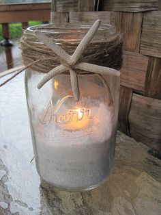 We love this simple, easy idea. Take a mason jar; fill with sand (if you don't live near the beach, you can use play sand from the home improvement stores); place a votive candle within and wrap the top with twine and a starfish. You just created a beach cottage look for your deck, tabletop or line the walkway for a special event.   # Pin++ for Pinterest #