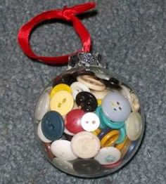What a wonderful way to display and enjoy Great-grandma's button collection!