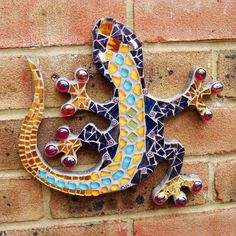 This unique mosaic wall plaque will add a fun element to a plain wall inside;