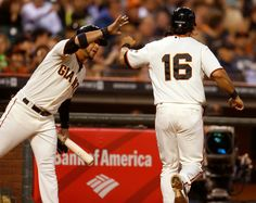 San Francisco Giants' Angel Pagan (16) high-fives San Francisco Giants' Gregor Blanco (7) after Pagan scored a run against the Arizona Diamondbacks in the first inning at AT&T Park in San Francisco, Calif., on Tuesday, Sept. 9, 2014.  (Nhat V. Meyer/Bay Area News Group)