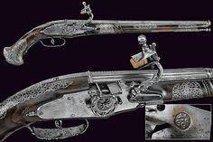 A beautiful pair of wheel-lock pistols by Giovan Antonio Gavacciolo, 17th century.