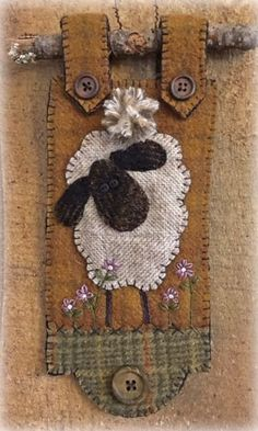 Sebastian Pattern for Mini Wall Hanging # Sebastian is a whimsical wall hanging featuring a woolen sheep grazing in a meadow of embroidered wildflowers. The mini wall hanging is displayed on a stick. The fininshed project measures 4 wide x 10 long. Motifs Applique Laine, Wool Applique Patterns, Felt Applique, Quilt Patterns, Sheep Crafts, Felt Crafts, Fabric Crafts, Sewing Crafts, Wood Crafts