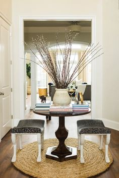 In a Hagerstown, Maryland, residence, a round #sisal #rug greets guests in the #entry. Designed by Stephanie Gamble Interiors. #interior #design