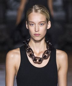 The XXL chain at Stella McCartney  Stella McCartney's goal was to translate the idea of quiet, female confidence, onto the runway. Her Spring/Summer 2015 collection did just that, combining softly tinted florals with audacious, chunky chains, adding force to the gentle tapering of a black dress.