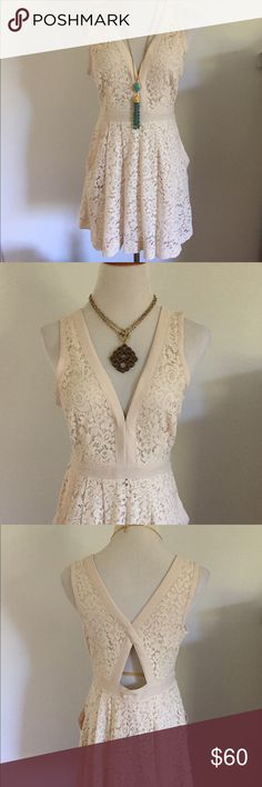Free People Cream Lace Mini Dress Lovely in Lace cream Lace dress * V-neck and back * Fitted bodice * Pleated waist * Side slip pockets * Back cut-out back * A-line hem * Tonal top stitching and panel seaming * Hidden side zipper . Eyehook close on neck  Material: 40% cotton, 30% nylon and 30% rayon shell; 100% polyester lining Free People Dresses Mini