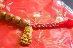 Original Design by Rough Luck Shop Ready to ship worldwide right from Florida! Hand crafted with 2x satin cords, each chinese good luck knot to resemble prayer beads. Intricately and neatly I spaced each knot with a following 9mm wood bead. I sealed it with chinese good luck red wax cord and a beautiful Kwan Yin Goddess of Mercy tiger eye gemstone. This style Mala creation I dedicate to my mom who was the first in my life to give me prayer beads. Kwan Yin - Goddess of mercy - The Mother of…