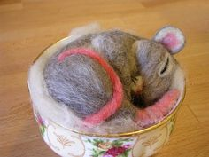 Needle felted mouse ~restlesswillow on deviantART - love that it's resting in a teacup, so cute! I could do without the pink rat-like features though. #Felting #Mouse #Crafts - pb≈