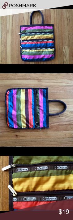 LE SPORTSAC Tote Striped Multicolored Bag Striped Multi-Colored Rip-Stop Nylon Bag with 3 stacked zippered pockets on the front side. Measures 14 x 14 1/2. Converts to a shoulder or messenger bag. LIKE NEW inside and out. Open main compartment with dark brown interior. Other side of bag has a compartment with magnetic closure, a smaller zippered pouch inside, and striped interior I do not trade or sell outside PoshPlease use the offer button to negotiate prices Le Sportsac Bags Totes