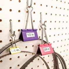 Clever Ways to Store Tools- store straps on binder clips- peg board - garage