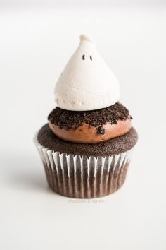 Ghost Cupcakes Recipe ~ Says: The flavor is outrageously delicious. The vanilla and chocolate go hand-in-hand in every bite. And the layers of flavor go from the cupcake, to the icing and to the meringue!