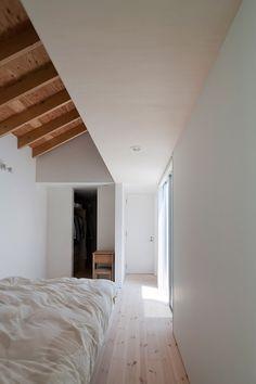 slanted ceilings, exposed rafters, minimal yet friendly.