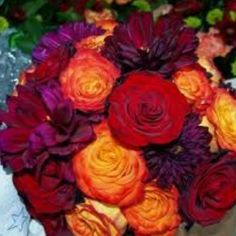 Red orange and sangria flowers. Love the rich colors in this bouquet