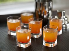 Tropical Kamikaze Shooter (2 strawberries   2 orange slices   Ice   1-ounce lime juice   1/2-ounce orange liqueur   1/2-ounce raspberry liqueur   1 1/2 ounces vodka)
