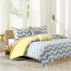 Bring a pop of pattern to your master suite or guest bedroom with this chic comforter set, showcasing a chevron motif in gray and yellow.  ...