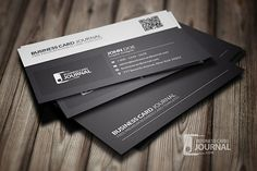 Clean and stylish black and white business card with QR code, available for free download as PSD file.