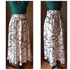 """Vintage Nautical Rope Full Maxi Skirt Incredible vintage skirt featuring an allover rope pattern in shades of navy blue set on a white floral background.  This skirt is stunning in person and is definitely a one of a kind stylish piece.  It is tapered at the top and flares out at the bottom for a nice full look. Made by the ILGWU.  This was originally part of a 3 piece set, but only the skirt survived. Condition: EUC - pristine.   Material: 100% polyester Waist: Minimum 26"""" with LOTS of…"""