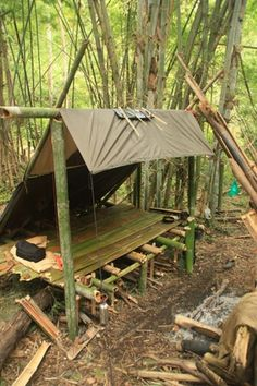 USGI PONCHO SHELTER with RAISED BED PLATFORM - off the ground, cover could be better, but good start