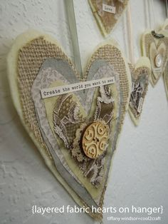It was a wooden pants hanger that inspired this project but you can create these layered fabric hearts to create a garland, door hanger and more! Featured on www.cool2craft.com #diycrafts