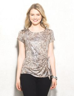While we know dresses are synonymous with parties, so is this shimmery top. Pair it with palazzos for the easiest (not to mention deceptively comfiest) going-out ensemble ever. Allover abstract print with silver metallic foil print. Domestic.