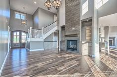 We love shiplap!  Beautiful open concept great room.  Engineered wood floors.