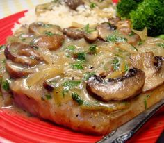 Slow cooker pork chops with mushroom-wine sauce.Delicious pork chops in creamy mushroom sauce with dry white wine cooked in slow cooker.