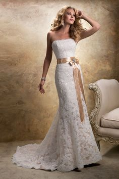Maggie Sottero  Add a subtle hint of color with this champagne underlay and satin sash. You'll be the picture of classic elegance. Gown, about $999, by Maggie Sottero.