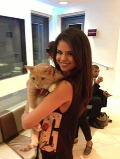 Selena Gomez holds a kitty!
