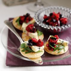 Blueberry and Stilton Blinis Put your Christmas cheese platter classics to good use with this light starter. The salsa that tops these blinis not only tastes good with Stilton but with cheeses including Brie, Camembert and Leicester. Christmas Canapes, Christmas Lunch, Christmas Recipes, Christmas Cheese, Christmas Buffet, Christmas Foods, Christmas 2019, Christmas Gifts, Ideas Para Canapés