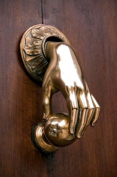 Charmant A Brass Hand Door Knocker