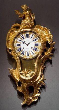 A Very Important and Rare Louis XV Gilt Bronze Cartel Clock / masterpiecefair.com