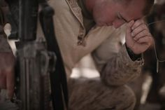 A US Marine of 3rd Battalion, 6th Marines, holds a dog tag of a fallen comrade as he gives his final respects during a memorial ceremony for four fallen comrades, at their base in Marjah, Helmand province, southern Afghanistan, on March 26, 2010. (MAURICIO LIMA/AFP/Getty Images)