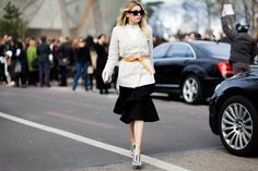 Camille Charrière wearing a Carin Wester blazer, Acne Studios belt, Thakoon ruffled skirt and Chloe wedges, before the Louis Vuitton Fall 2015 fashion show in Paris, France