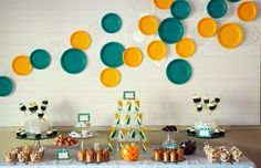 Pretty party table with paper plates as a backdrop.  Brilliant!