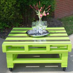 Pallet Coffee Table with 3 inch casters and 1/4 inch tempered glass table top. Measures 39 1/4in. x 35 1/4in. Height 19 1/2in. Color shown Lemon Grass Green to make a statement with Kona accents made from Poplar!