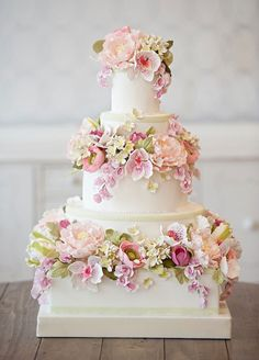 5. Elegant sugar blooms turn this cake into a stunning spring statement.