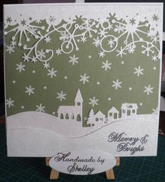 Winter Village die by Marianne Design. Frostyville Border die by Memory Box. Jolly Happy Christmas paper pad by Dovecraft (Trimcraft). Peel-off italic letters by Craft Creations.