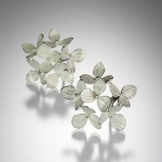 "These naturally beautiful and artful John Iversen hydrangea earrings are a Quadrum favorite.  Featuring an arrangement of six bright sterling silver hydrangea blossoms, with a post and clip back.  The ""Medium 6 Part Hydrangeas"" would make a lovely birthday or anniversary gift!<br><br>Diameter measures approximately 1""."
