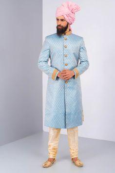 OSHNAAR blue brocade sherwani with golden kurta churidaar embroidered buttons #flyrobe #groom #groomwear #groomsherwani #sherwani #flyrobe #wedding #designersherwani