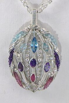 topaz, amethyst, ruby, tourmaline, sterling silver wire wrap pendant. $550.00, via Etsy.