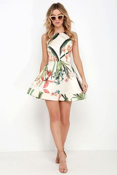 Like a stunning display of pretty blooms, the Sunny Centerpiece Cream Floral Print Skater Dress will instantly brighten any room it enters! Satin fabric has a graphic floral print (in green, rust orange, and slate blue) that covers the apron neckline and darted bodice. Skinny halter straps transition into a wide, tying bow atop the open back, and skater skirt with structured hem. Hidden back zipper with clasp.