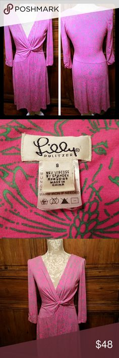 """Lilly Pulitzer Pink Faux Wrap dress size S Lilly Pulitzer Faux Wrap dress in pattern Hidden Kitten  pink and green  Size Small  95% Viscose 5% spandex  3/4 sleeves ruched armpit to armpit laying flat 16"""" Waist 13"""" Sleeve 17"""" Length 37"""" Minor piling and wash wear Dresses"""