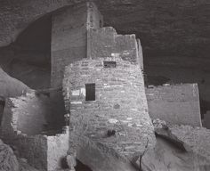 1942 Detail, Cliff Palace Ruin, Mesa Verde National Park, Colorado round tower with window, partly constructed lower wall at left, rock overhang] by Ansel Adams 76.89.85