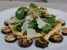 Grilled Zucchini with Arugula, Pecorino, and Pinenut Salad  A quick vegetarian meal from the grill with zucchini and arugula.