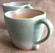 Unique coffee/tea mugs in an awesome green and peach glaze. Wheel thrown stoneware mugs available on ETSY!