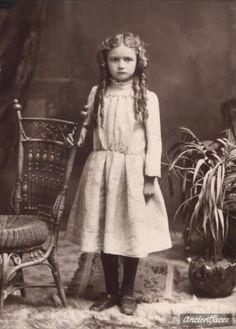 This girl is absolutely adorable - from her ringlets, the pout, and what looks like a giant tear on her right cheek! Little Myrtle Boyd didn't want her picture taken in 1904.