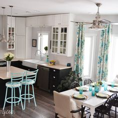 LOOOOOOOVVVVVEEEEEE this kitchen.   Breakdown of their costs: Christina Dennis Canada Yes. Here's the breakdown if you're curious: cupboards & countertops (IKEA) $8500, light fixtures (wholesale, Kichler) $400, range hood (IKEA) $300, taps (wholesale, Pfister) $500, drapes (fabric, handmade) $120, hardware (wholesale) $60, labour we did ourselves, appliances we had already, furniture was repainted.