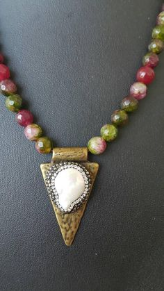 1 strand faceted cut rainbow jade beads (look like rainbow tourmaline) with pearl antique gold colored metal pendant. ABOUT Jewelry Designer of Emotional Dreams offers an exciting collection, designed and handmade by designer herself. You will find a selection of rich gemstone
